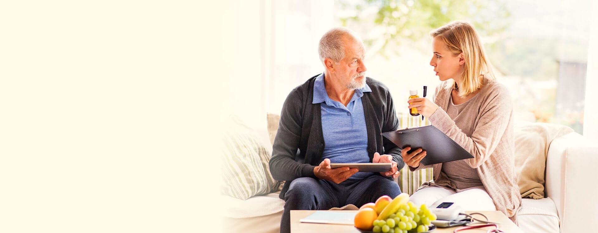 caregiver helping elder man on medicine dossage concept