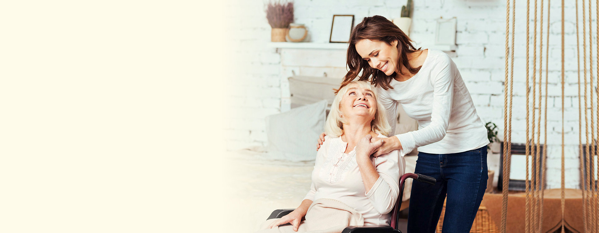 elder woman in the wheelchair with caregiver