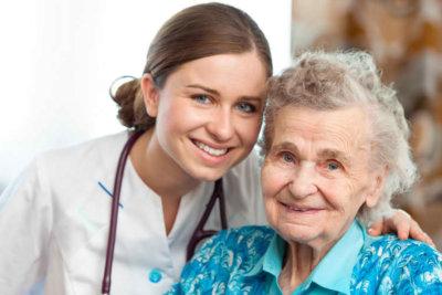 caregiver hugging an elder woman in a wheelchair concept
