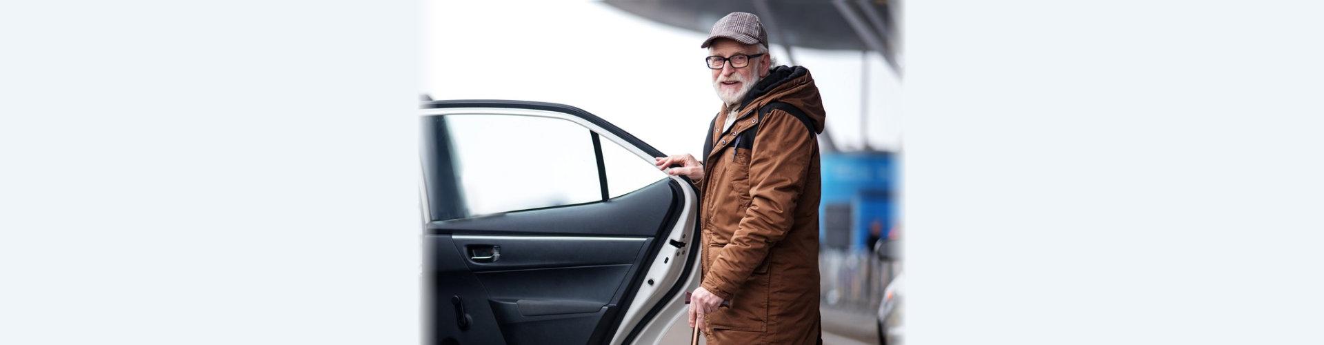 elder man entering a private car concept